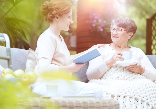 caregiver telling a story to the elderly