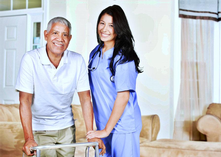 elderly and caregiver smiling