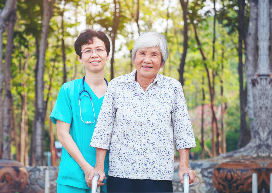 outdoor photo of an elderly and caregiver