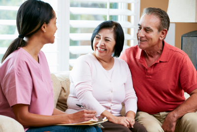 caregiver talking to the senior couple