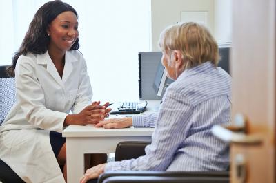 nurse talking to the senior woman